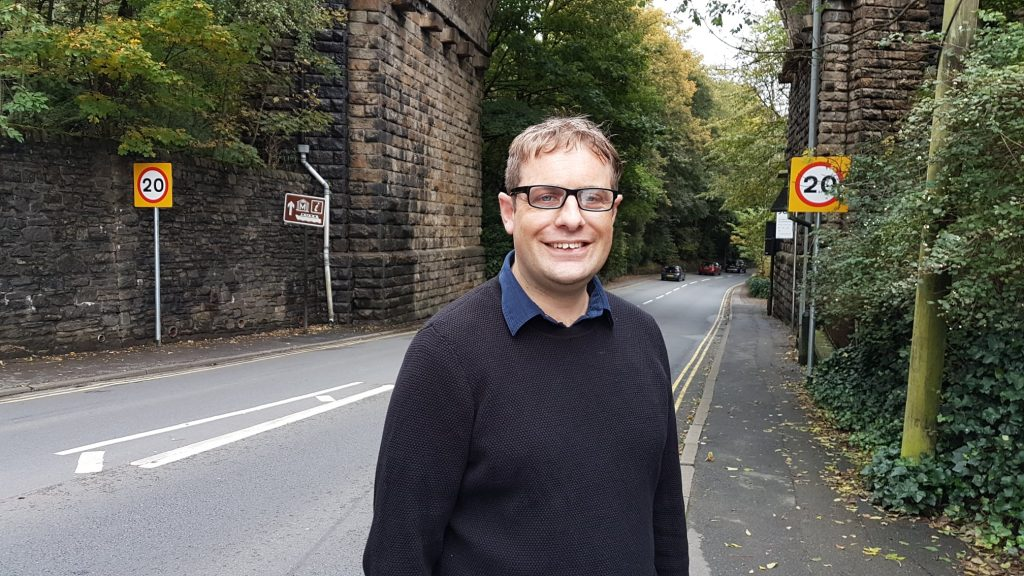 Garth Harkness at the new 20mph signs in Uppermill